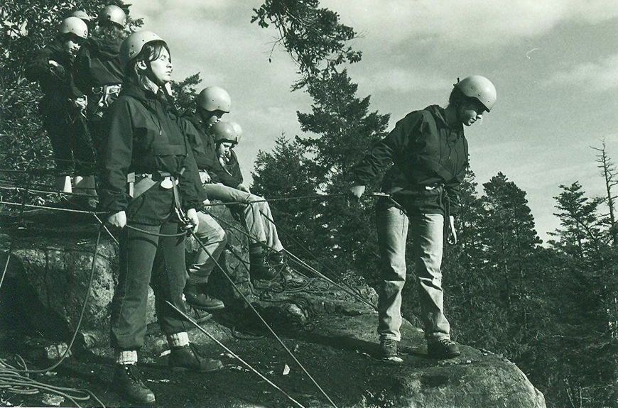 1974/75: Mountain rescue service students practice techniques at a cliff on a trail to Matheson Lake.
